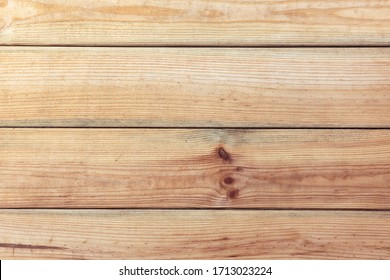 Background texture of natural spruce table boards with knots. Horizontal orientation. Top view