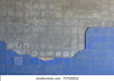 background texture of old chipped ceramic tiles