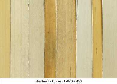 Background texture of old paperback book pages in varying stages of yellowing.