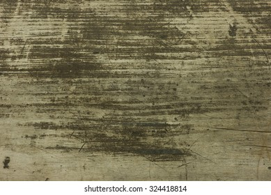 Background of a texture of an old scratched and dirty plank of wood