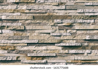 Background, texture of an old wall made of natural stone blocks.