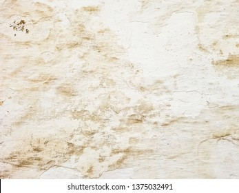 Background and texture of the old and whitewashed wall of an ancient house