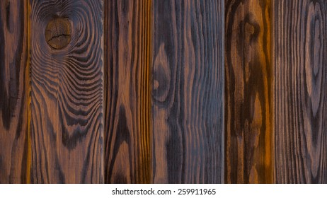 background texture of old wooden fence close up vertical red