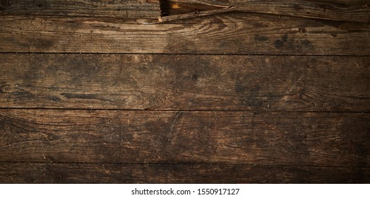 Background texture of an old wooden panel composed of boards or planks for a vintage or rustic themed concept