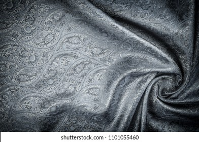 Background texture, pattern. Gray Paisley Silk Jacquard is an intricately woven shiny fabric with a tonal design woven in. The weave creates the effect of a 'shadow' pattern or print.