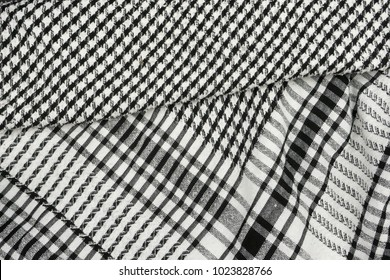 Background texture, pattern. Scarf wool like Yasser Arafat. The Palestinian keffiyeh is a gender-neutral checkered black and white scarf that is usually worn around the neck or head.