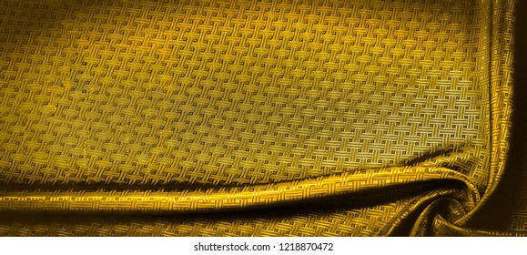 Background texture, pattern. Yellow, mustard silk fabric with a small checkered pattern. Muffled yellow braided with subtitles with sparkles - a bright chart-plot design. Individual pieces.