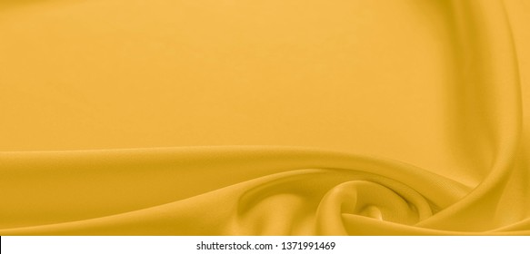 background texture, pattern. Yellow silk fabric. A very light faux dupioni silk fabric with rich drape and slub texture with a subtle matte sheen. It is perfect for your design accents.