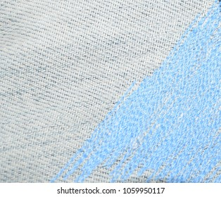 Background and texture. Photos of denim material with decorative shtatnoy patch. Blue background with turquoise embroidery. Hobby, handmade, home decor.