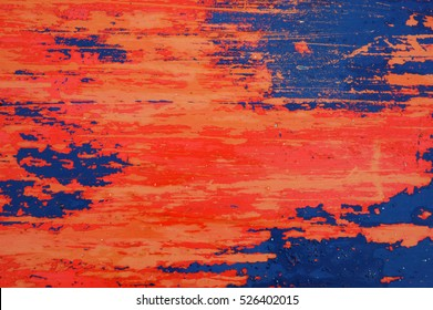 Background texture of red and blue paint peeling off a metal plate