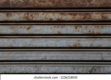 Background texture Red, brown rusty weathered grunge aged vintage retro old industrial abstract art design metal aluminum garage warehouse house door outdoor interior natural rough pattern stain