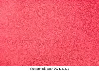 Background texture of red fleece. Plush velour closeup.
