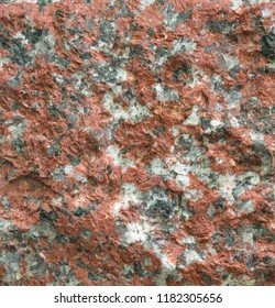 background and texture of  red granite stone wall