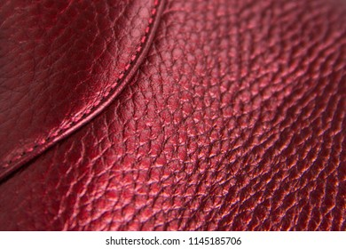 Background texture of red leather floater with stitch