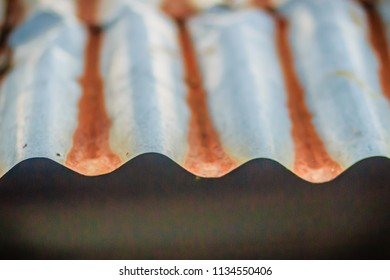 Background texture of the roof of old zinc sheet, metal roof sheet with rusty texture, rusty metal roof sheet, rusty zinc texture