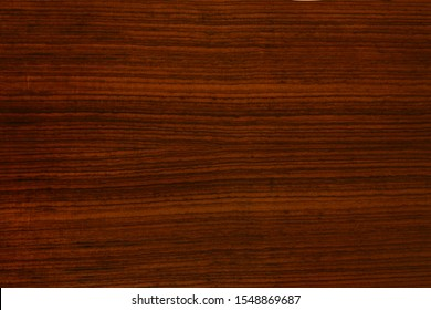 background and texture of rosewood on furniture surface