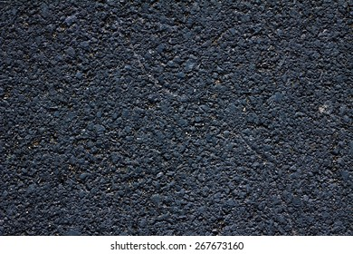 background texture of rough asphalt in daylight