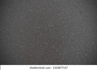 background texture of rough black asphalt