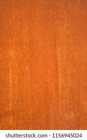 Background or texture: The rusted surface of a steel plate.