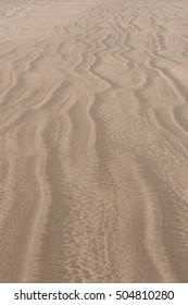Background or Texture of Sand at Low Tide on the Beach at Saunton on the Coast of North Devon, England, UK