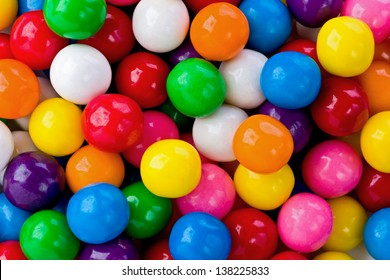 background texture of several colored gumballs.