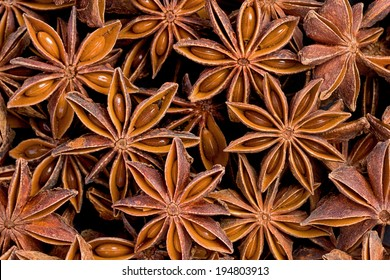 Background texture of several star anise fruits and seeds.