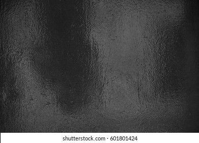 Background texture of shiny black grey foil