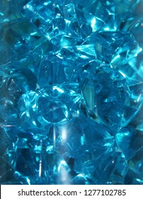 Background or texture, shiny blue glass crystals.