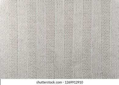 Background, texture - the surface of wool knitted fabric close up