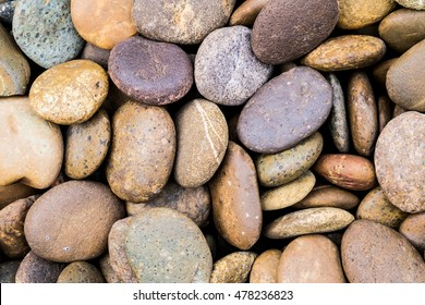 Background texture of swimming pool/garden pile of pebbles