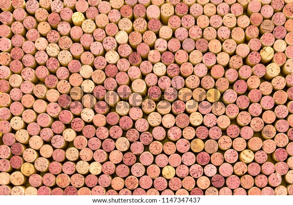 Background texture of tightly packed used red and white wine bottle corks viewed on end from overhead