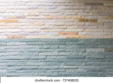 Background texture of two tone soft blue and cream in patterns of brick
