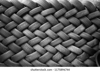 Background, texture of the wall of tires laid at an angle. Black tire rubber, vehicle part, spare part.