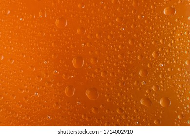 background texture of a water drop on a orange surface