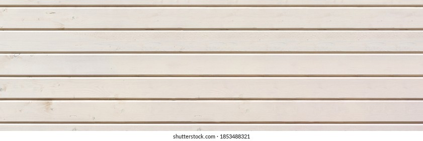 Background and texture of wood. Wooden cladding on the facade of the house