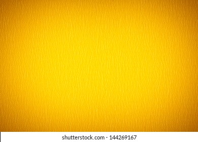 Background texture of yellow fabric closeup with vignette