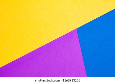 Background (texture) of yellow, purple and blue paper