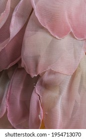Background texture.Abstract background from pale pink pieces of fabric. High quality photo