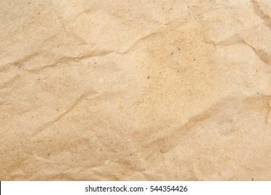 Background of textured paper with spots and folds