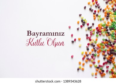 background textures with colourful candies and happy ramadan feast wording