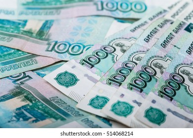 Background of thousand russian roubles banknotes, close-up