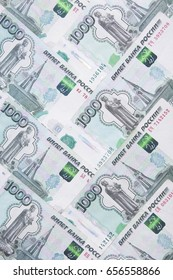 Background of thousands of ruble notes. Wealth, finance