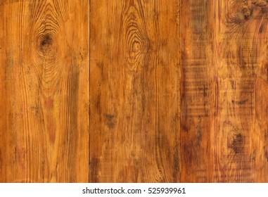 Background of three old dark wooden planks