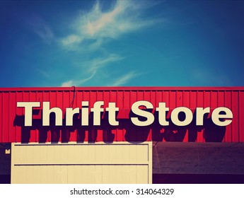 background of a thrift store front sign in the summer time toned with a retro vintage instagram filter app or action effect