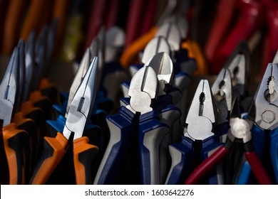 Background tools electrician fitter pliers nippers close-up.