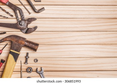 Background of tools and equipment on wooden table.