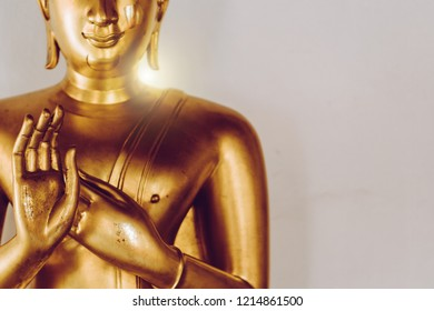 Background traditional buddhist culture in buddhist temple woman pray for good luck, peaceful and holy meditation relax. Buddha statue in Thai wat temple to people to worship and respect on vesak day