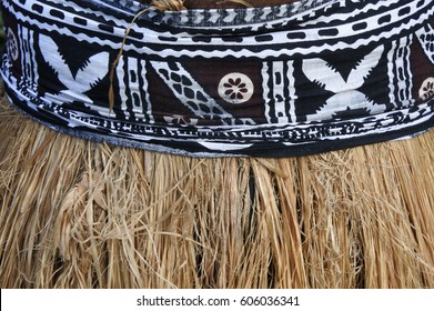 Background of traditional Pacific Island straw skirt and tapa cloth, a barkcloth made primarily in Tonga, Samoa and Fiji