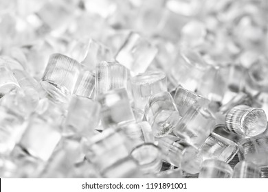 Background of transparent plastic granules. Abstract background of artificial diamonds.