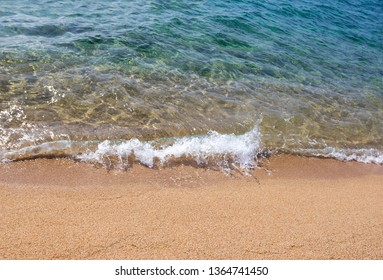 Background with transparent water and sandy beach
